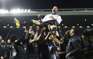 Chelsea's John Terry is thrown in the air by his teammates as they celebrate winning the Premier League title