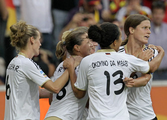 Germany's Garefrekes celebrate's her goal with teammates a goal against  France during their Women's World Cup Group A soccer match in Monchengladbach