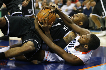 Brooklyn Nets point guard C.J. Watson (1) fights for a loose ball against Charlotte Bobcats small forward Michael Kidd-Gilchrist (14) during the second half of their NBA basketball game in Charlotte