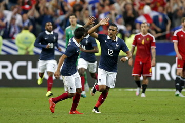 France's Dimitri Payet celebrates with Benoit Tremoulinas after scoring a goal against Belgium during their international friendly soccer match at the Stade de France stadium in Saint-Denis, near Paris