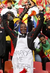 A fan cheers ahead of the 2010 World Cup Group G soccer match between Ivory Coast and Portugal in Port Elizabeth