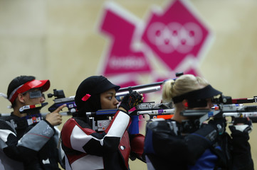 Qatar's Bahya Mansour Al Hamad takes aim during the women's 10m air rifle qualification competition at the London 2012 Olympic Games in the Royal Artillery Barracks at Woolwich in London