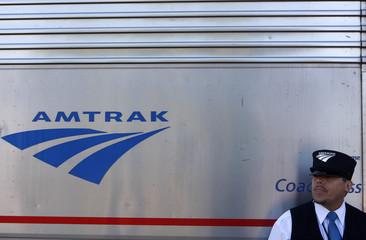 Amtrak train conductor Loxie Sanders leans against the 5 California Zephyr Amtrak train in Winnemucca, Nevada