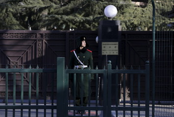 A paramilitary policeman stands guard in front of the North Korean embassy in Beijing