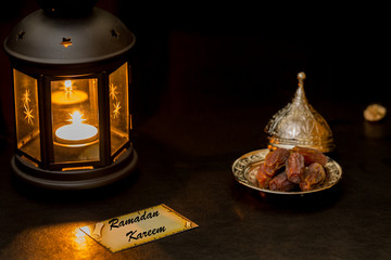 Ramadan kareem card with lantern and dates in darkness