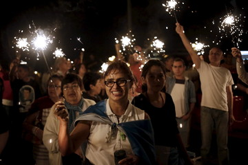 Demonstrators hold sparkler sticks during a protest demanding the resignation of Guatemala's President Perez Molina, in Guatemala City