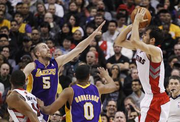 Raptors Calderon puts up a shot over Lakers Blake during their NBA basketball game in Toronto