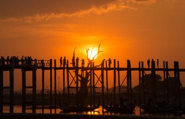 Beautiful sunset with the silhouette of U Bein bridge, Mandalay region of Myanmar.