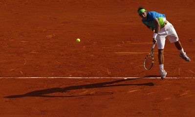 Rafael Nadal of Spain serves during his semi-final match against Jurgen Melzer of Austria at the French Open tennis tournament at Roland Garros in Paris
