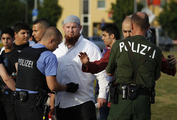 A policeman checks Islamic cleric Vogel as he arrives for a pro-Islam demonstration in Frankfurt