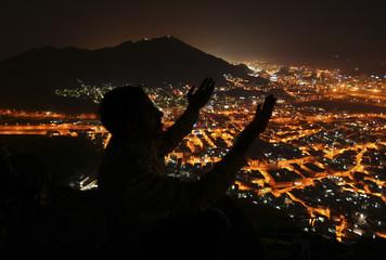 A Muslim pilgrim prays atop Mount Al-Noor during the annual haj pilgrimage in Mecca