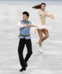 Huang and Zheng of China perform during the ice dance short dance segment at ISU Grand Prix of Figure Skating's NHK Trophy event in Sendai