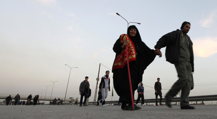 Iraqi Shiite Muslim pilgrims walk to the holy city of Kerbala to mark Arbain in Baghdad's Doura District