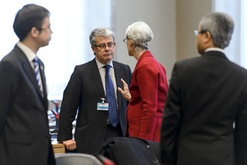 U.S. Under Secretary of State for Political Affairs Sherman speaks with French Foreign Ministry Political Director Audibert before a meeting at the United Nations offices in Geneva