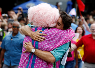 Canada's Prime Minister Justin Trudeau hugs a supporter while walking in the Vancouver Pride Parade