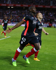 Standard Liege's Paul Jose M'poku celebrates after scoring against Sevilla during their soccer match in Seville