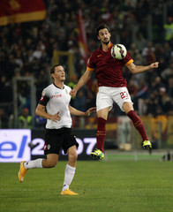 AS Roma's Davide Astori controls the ball as he is challenged by Cesena's Milan Djuric  during their Italian Serie A soccer match at the Olympic stadium in Rome