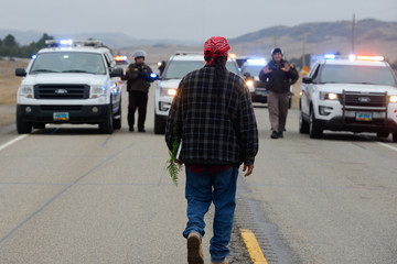 A protester blocks highway 1806 in Mandan during a protest against plans to pass the Dakota Access pipeline near the Standing Rock Indian Reservation