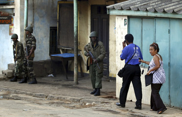 Members of Madagascar's security force take up positions as others storm an army barracks in Ivato