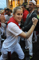 Lauren Johnson, 24, from Sydney, Australia poses before the fourth running of the bulls of the San Fermin festival in Pamplona