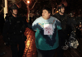 A protester is arrested as Los Angeles police officers evict protesters from the Occupy LA encampment outside City Hall in Los Angeles