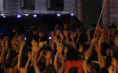 """""""Indignant"""" demonstrators raise their hands outside Parliament during a protest against politicians, banks, the economic crisis and the austerity measures of Europe in Madrid"""