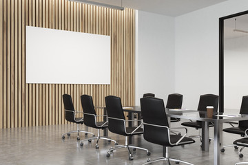 Wooden meeting room with poster