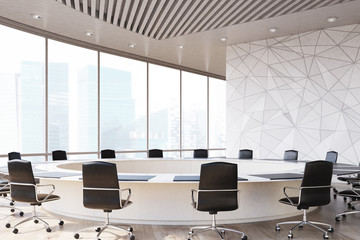 Round meeting room, black chairs, marble