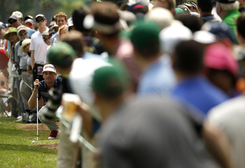 Keegan Bradley of the U.S. looks over his second shot on the first fairway during third round play of the Masters golf tournament at the Augusta National Golf Course in Augusta