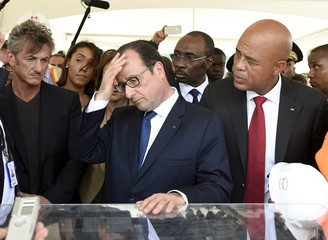 Sean Penn, Francois Hollande and Michel Martelly attend a presentation of the future Haiti State University hospital, in Port-au-Prince
