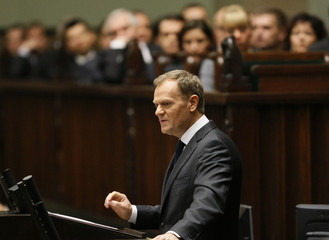 Poland's PM Tusk delivers a speech at Parliament in Warsaw