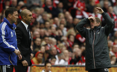 Liverpool's coach Dalglish reacts during their FA Cup final soccer match against Chelsea at Wembley Stadium in London