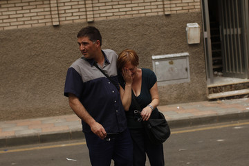 A woman is consoled by her husband in front of their building after being found in the ruins following a 5.3 magnitude earthquake that rocked the town of Lorca in southeastern Spain