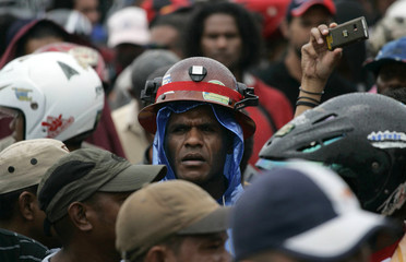 Workers from Freeport McMoRan Copper & Gold take part in a rally outside the local Manpower Agency office in Timika