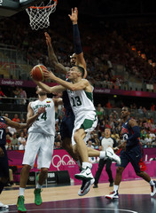 Lithuania's Jasikevicius is guarded by Chandler of the U.S.  during their men's preliminary round Group A basketball match at the Basketball Arena during the London 2012 Olympic Games