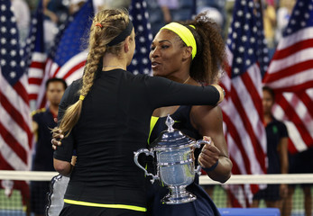 Williams of the U.S. is congratulated by Azarenka of Belarus after their women's singles finals match at the U.S. Open tennis tournament in New York