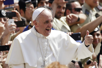 Pope Francis shows a thumbs-up sign as he arrives to lead his Wednesday general audience in Saint Peter's Square at the Vatican