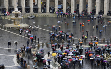 Faithful wait during the conclave in Saint Peter's Square at the Vatican