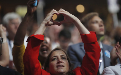 A delegate makes a heart symbol as the survivors and family members of gun victims speak at the Democratic National Convention in Philadelphia