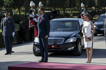 Spain's King Felipe and Queen Letizia arrive to welcome Peru's President Ollanta Humala during an official welcoming ceremony at Madrid's El Pardo Palace