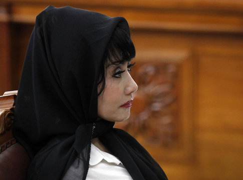 Malinda Dee, a former Citibank relationship manager, listens to the judges during her trial at a South Jakarta court
