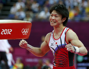 Kohei Uchimura of Japan celebrates after competing in the vault during the men's individual all-around gymnastics final in London