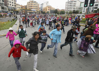 """Children arrive at Hernando Siles Stadium for a Christmas celebration organised by """"Carros de Fuego"""", a catholic organisation that donates free toys, in La Paz"""