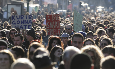 People demonstrate against a planned tax law in Skopje