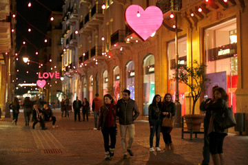 People take pictures in front of decorations ahead of  Valentine's day in down town Beirut