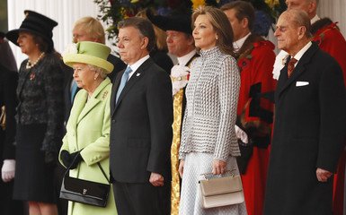 Britain's Queen Elizabeth and Prince Philip stand next to Colombia's President Juan Manuel Santos and his wife Maria Clemencia de Santos during the ceremonial welcome at Horse Guards Parade for Colombia's President, in central London