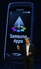 Thomas Richter, Samsung Telecommunications' director of portfolio management, presents the new 'Wave' smartphone during the Mobile World Congress in Barcelona