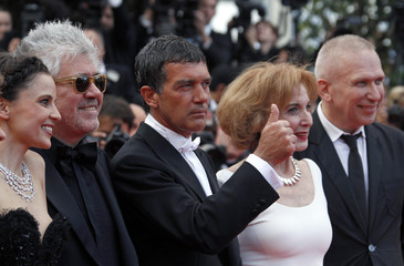 """Director Almodovar poses on the red carpet with cast members Anaya, Banderas, Paredes and fashion designer Gaultier for the screening of the film """"La Piel Que Habito"""" in competition at the 64th Cannes F"""