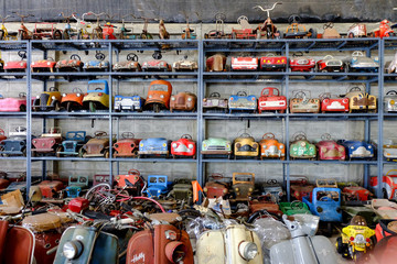 a lot of old toy cars and bikes collection