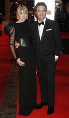 Actor Mark Ruffalo and his wife Sunrise Coigney arrive at the BAFTA award ceremony at the Royal Opera House in London